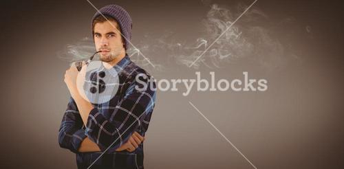 Composite image of portrait of hipster holding smoking pipe