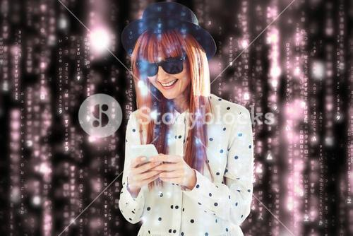 Composite image of smiling hipster woman texting with her smartphone