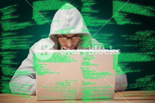 Composite image of creative businessman with hooded shirt working on laptop