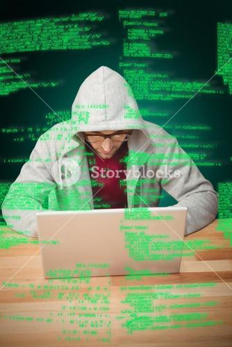 Composite image of man with hooded shirt working on laptop