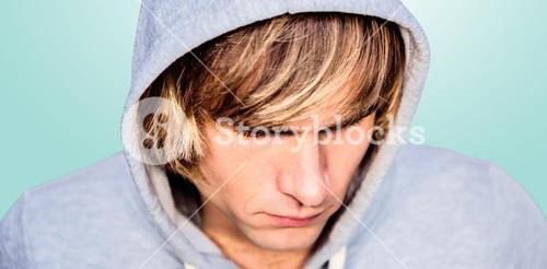 Composite image of  man in hood jacket hacking a laptop