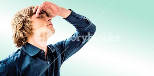 Composite image of troubled hipster businessman holding his head