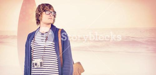 Composite image of thoughtful hipster looking away