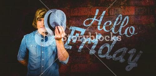 Composite image of focused hipster man hiding his face