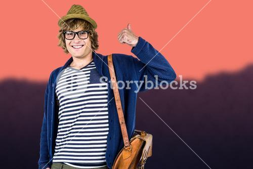 Composite image of smiling hipster making thumbs up