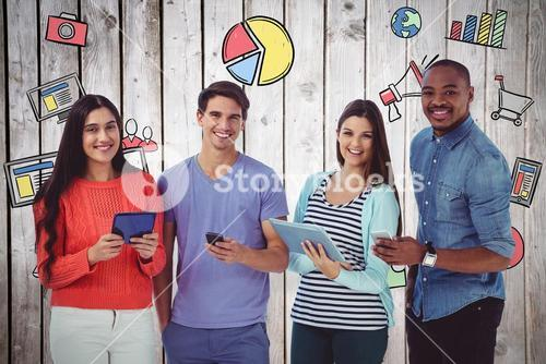 Composite image of young creative team looking at phones and tablets