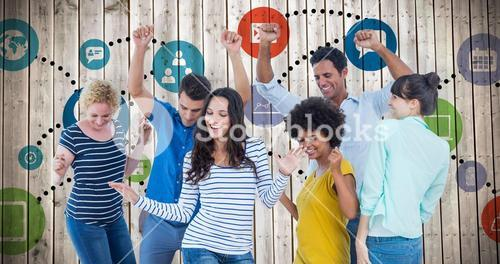 Composite image of creative business team having fun