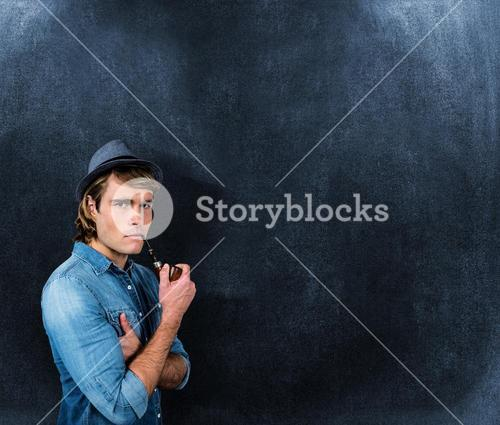 Composite image of serious hipster smoking pipe