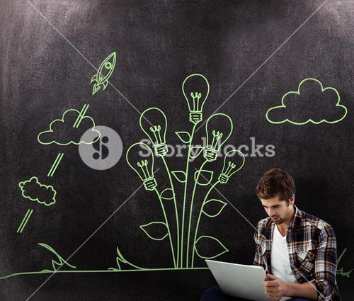 Composite image of hipster working on laptop