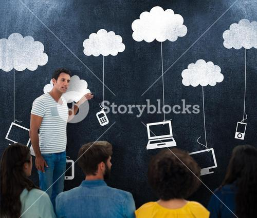Composite image of creative business people at work by blackboard