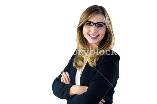 Smiling woman with arms crossed looking at the camera
