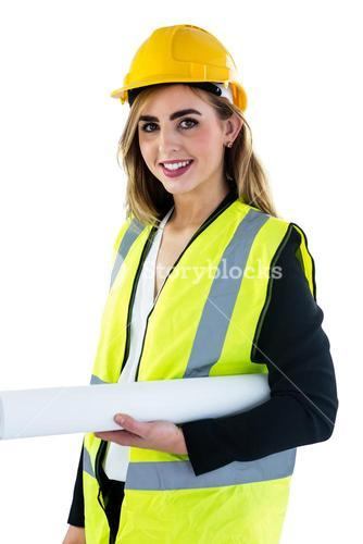 Smiling woman holding construction plan