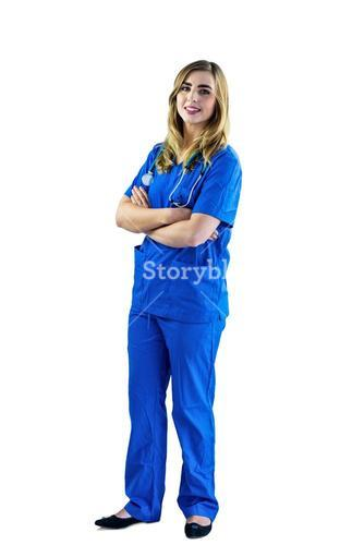 Smiling nurse with arms crossed