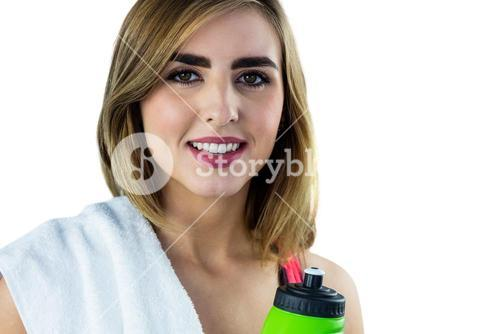 Smiling woman with sport equipment