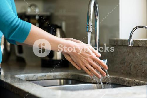 Pretty woman washing her hands