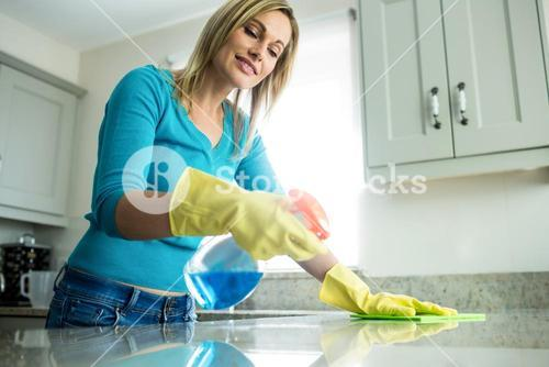 Pretty woman doing her house chores