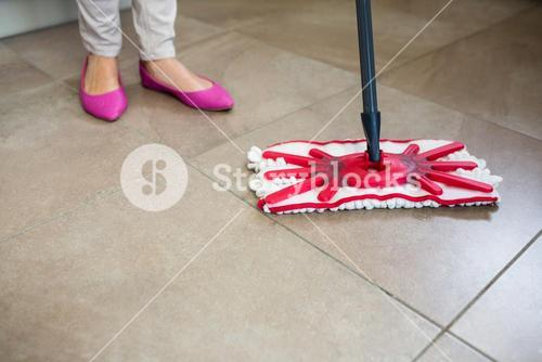 Woman swiping the kitchen floor