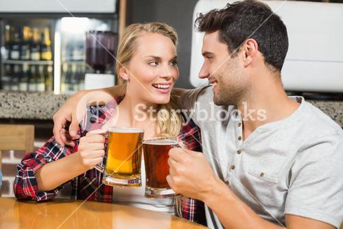 Couple toasting with beers