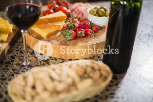 Wine bottle with a glass and a buch of food