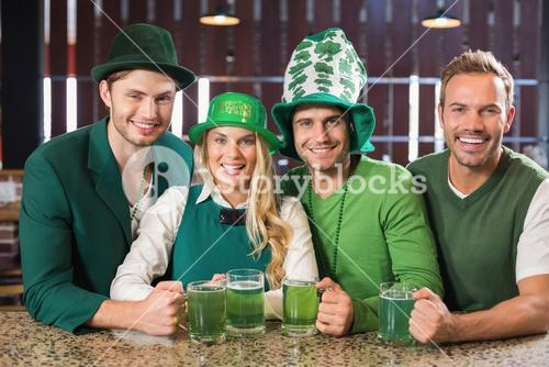 Friends wearing St. Patricks day associated clothes