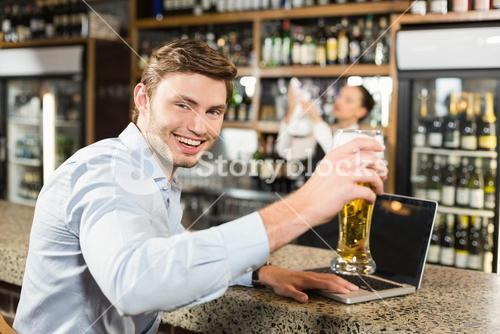 Man toasting a beer