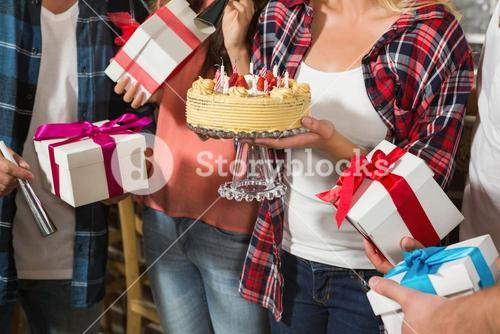 Cute woman celebrating her birthday with a group of friends