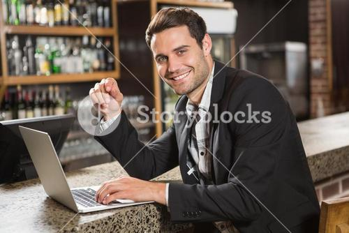 Handsome man using laptop computer