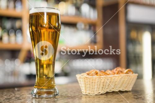 View of a pint of beer and pretzels
