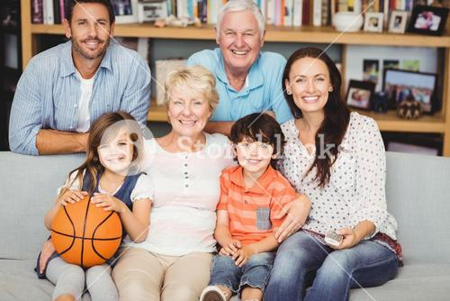 Portrait of smiling family watching basketball match