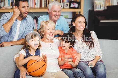 Smiling family watching basketball match