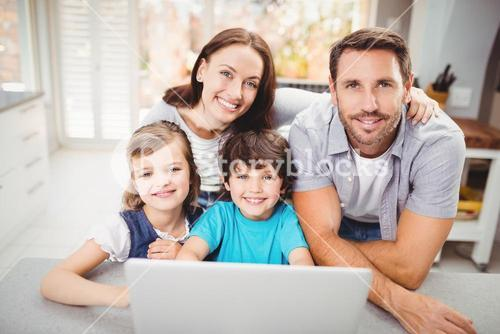 Portrait of happy family with laptop