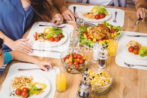 High angle view of family with food on dining table