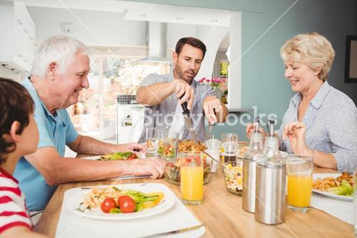 Happy family sitting at dining table