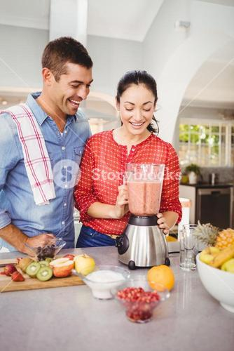 Laughing couple with fruit juice