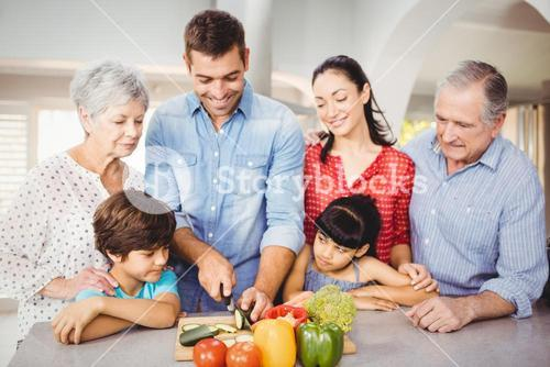 Happy man with family by kitchen table