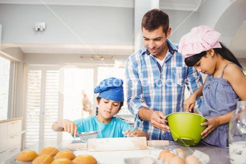 Children helping father in preparing food