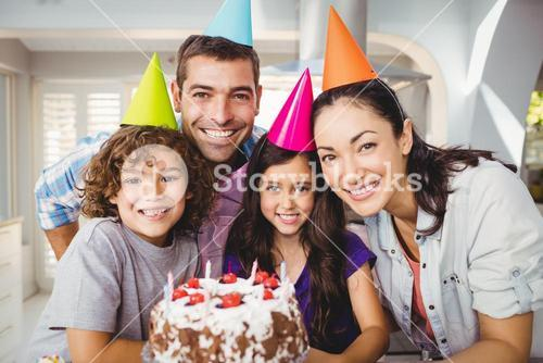 Cheerful family celebrating birthday