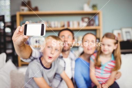 Family taking selfie on mobile phone