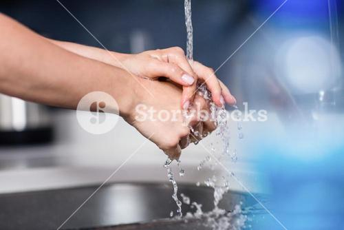 Cropped image of woman washing hands