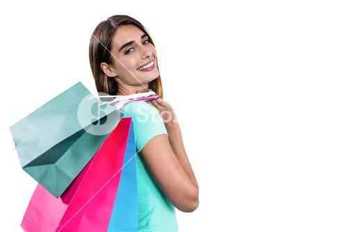 Portrait of hapy woman holding shopping bags