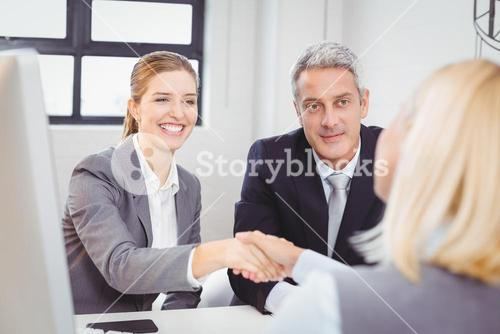Smart business people handshaking with client
