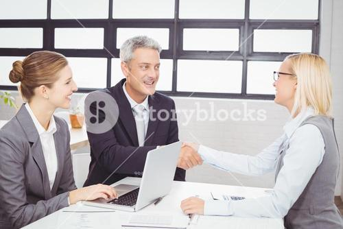 Business people handshaking with client