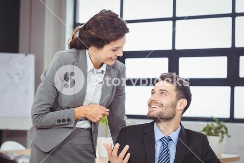 Business people smiling while talking