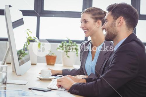 Business people working at computer desk in office