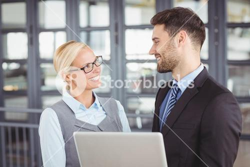 Business people looking face to face in office