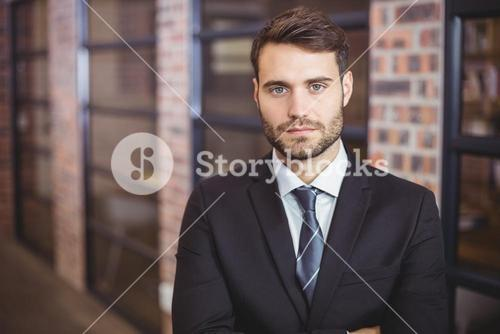 Portrait of confident businessman standing in office