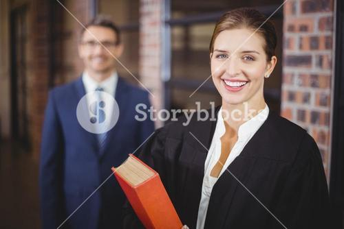 Happy female lawyer with businessman