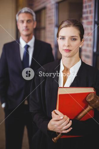 Female lawyer with male colleague in background