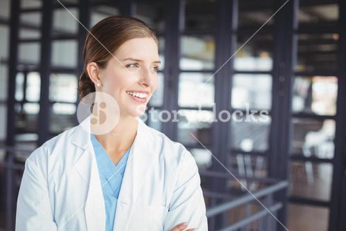 Smiling female doctor looking away