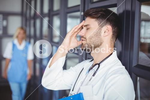 Close-up of male doctor suffering from headache